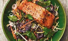 Yotam Ottolenghi's black rice noodles and mango salad with soy roast salmon.
