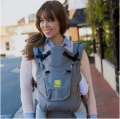 Our flagship carrier, whose classic design and innovative features started a baby-wearing comfort revolution! With 6 ergonomic carrying positions, signature lumbar support, and near-limitless adjustability. Best Baby Carrier, Baby Online, Baby Shop, Baby Wearing, Infant, Celebs, The Originals, Children, How To Wear