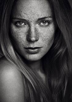 Beautiful black and white freckles. Light, detail, expression all fantastic. The face is neutral but alive and mysterious too. Love it.
