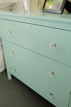 "dresser ""as is"" at IKEA, patched the scratches, primed it and painted with benjamin moore's - ""arctic ice"""