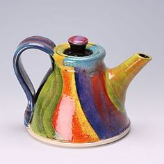 John Pollex first developed his reputation in the 1970's and early 1980's for is traditional English slipware. After an inspiring tour of New Zealand he changed his work and he is now famed for his highly colourful slipware. SOLD