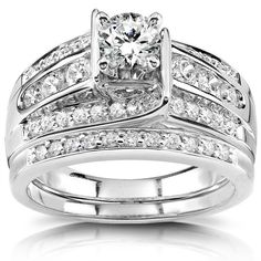 This white gold bridal rings set offers an engagement ring and matching band. The 14-karat white gold is plated with rhodium for a bright white finish. The center diamond is a round-cut, one-third carat diamond. Total gemstone weight is one carat.