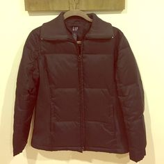 GAP quilted down puffer jacket. Size Small. GAP black puffer nylon down jacket with stretchy breathable material on sides. Worn only a few times it's in great like new condition aside from some peeling of the zipper (the actual zipper part) not noticeable aside from that great jacket great basic. Fits more like a medium GAP sizes run big. Bought not long ago. Selling cheap!!! GAP Jackets & Coats Puffers