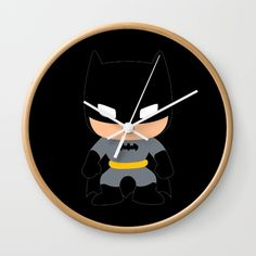"""Batman The Dark Knight - Available in natural wood, black or white frames, our 10"""" diameter unique Wall Clocks feature a high-impact plexiglass crystal face and a backside hook for easy hanging. Choose black or white hands to match your wall clock frame and art design choice. Clock sits 1.75"""" deep and requires 1 AA battery (not included)."""