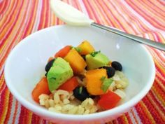Baby black bean and mango fiesta /// 2 T cooked brown rice  1 T diced avocado  1 T cooked black beans (If using canned, rinse well.)  1 T diced roasted red pepper  1/2 t minced cilantro  pinch of finely minced garlic  squirt of lime juice  pinch of sea salt and black pepper///  1.  Dice veggies to the size your baby can handle.  Babies who are being fed by a spoon need a smaller dice.  Babies who are self-feeding with hands need larger chunks to grasp.  Be mindful of baby's gumming ability…