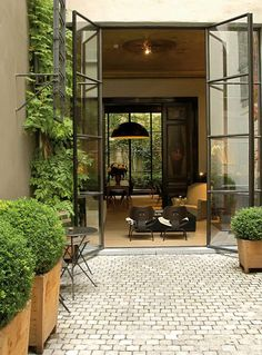 more steel french doors leading to a patio/courtyard Patio Interior, Interior And Exterior, Exterior Doors, Modern Interior, Craftsman Exterior, Cottage Exterior, Exterior Paint, Midcentury Modern, Indoor Outdoor Living