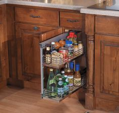 StarMark Cabinetry Base Pantry with Chrome/Wood Basket Shelves. All cooks want to be organized, but some homeowners don't want white plastic organizers. Wood organizers with chrome accents are a good choice for stylish storage.