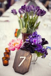 Cute and Easy Table Numbers (purchase wood block at craft store, spray paint to desired color, paint on number) #purple #flowers
