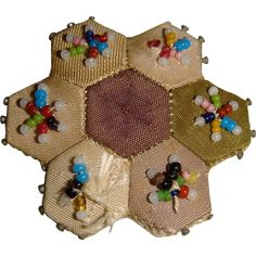 Tiny old patchwork bead decorated pin cushion