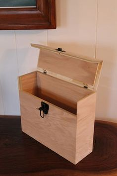You can paint the Office File Box Paperwork Organizer ($45, TilnicBox/etsy.com) or leave them in their natural red oak color. One great way to use them is one for each year -- they can be labeled. All your receipts get filed away here and then your tax information is all in one place.