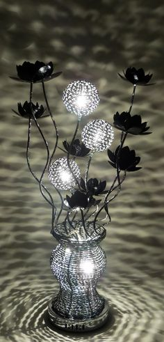 80cm tall Woven Wire Table Lamp, in Silver with Black intricacies and Bloomed Black Flowers - Silver and Black spherical shades are illuminated by halogen bulbs.