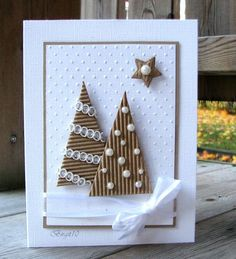Christmas card simply stated in white and kraft...luv the corregated kraft paper with pearls and lace...I could see a heart or leaf instead of trees on this card