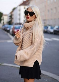 With black mini skirt and oversized sunglasses