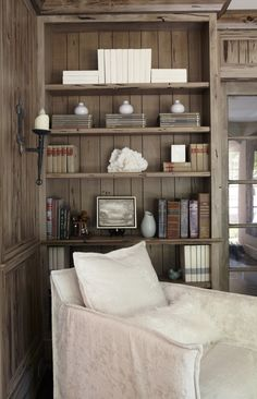 Gather similar items together, don't over-fill the shelves and keep the palette restrained is the recipe for this clean, uncluttered bookshelf (Jan Ware Designs)