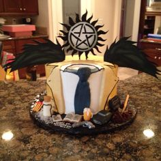 WHAT. CASTIEL CAKE. I NEED DIS. Not sure whether to pin under 'Food' or 'Supernatural'!