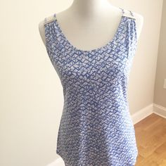 Michael Kors top Michael Kors top with a summer beachy vibe! Lightweight & stretchy for a comfortable & chic look. Would look great with white cropped pants! Size large & roomy - measurements: underarm to underarm is 21 with stretch to 24 and length is 25. NWT & retails for $80. No trades, no lowball offers. Thanks for shopping my closet!  Michael Kors Tops Tank Tops