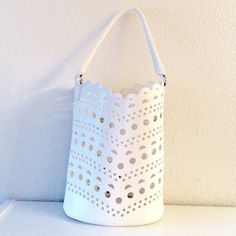 """Neiman Marcus White Summer Tote Bag Neiman Marcus Water Resistant Summer White Tote Bag. Hearts,Circle, Half Moon Cut Out Pattern. Material: Faux Leather. Measurements: Depth 5.5, Length 10, Width 11"""", Height 11"""", Strap Drop 7"""". Brand New Neiman Marcus Bags Totes"""