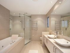 I like the natural\/off white tiles which  compliments the white bath and vanity creating a comfortable not cold or sterile environment