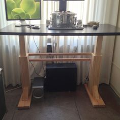 I really wanted a geek desk, but they're like 1,000 dollars. So I built my own for about 200 bucks (not including top). This is simply a regular desk that can rise up with a push of a button and turn into a standing desk. It takes about one minute to raise, speedier linear actuators are expensive. Parts Pair of linear actuators (found on eBay for 150) Premium pine (Home Depot 50 bucks) 12v power supply (found in my electronics junk box) wire screws electrical tape Tools miter sa...
