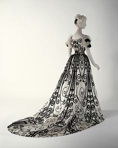 The Metropolitan Museum of Art  Design House: House of Worth (French, 1858–1956) Date: 1898–1900 Culture: French Medium: silk Dimensions: Length (a): 17 in. (43.2 cm) Length at CF (b): 42 1/4 in. (107.3 cm) Credit Line: Gift of Miss Eva Drexel Dahlgren, 1976 Accession Number: 1976.258.1a, b