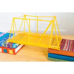 Building a spaghetti bridge applies the principles of science and math to a fun activity. Creating this type of bridge requires the use of design, planning and construction. Even though it is ...