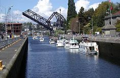 Seattle, WA - Ballard Locks (Hiram M. Crittenden Lock) - allow boats to travel between the salt water of Puget Sound and the fresh water of the Ship canal and on to Lake Union and Lake Washington.  Grounds are great for a picnic and concerts are occasionally held in the adjacent Botanical gardens.  Also a visitors center for history buffs.
