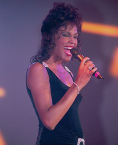 """Whitney Houston's recording of the song """"I Will Always Love You,"""" which was written by Dolly Parton in the 1970s, earned her superstar status and a slew of Grammys in 1994."""