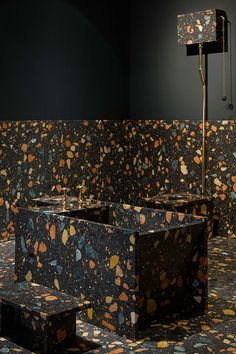 Dark terrazzo with colorful inserts for the bathroom floor, walls and the bathtub itself. Terrazzo inspiration for home interiors and redecoration ideas.