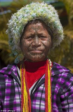 Variation: These women, both from the Chin tribe, have less prominent tattoos than those f...