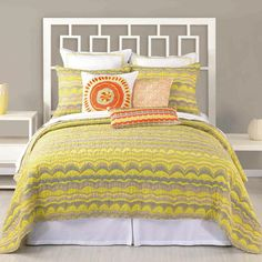 Quilted cotton sateen coverlet with a waves motif.   Product: CoverletConstruction Material: Cotton sateen