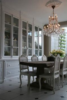 HUGE built-in china cabinet - the grayish white tones in this room are so pretty.