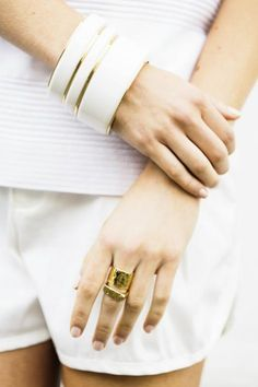 White bangles with gold rim by Ben-Amun for Isaac Manevitz