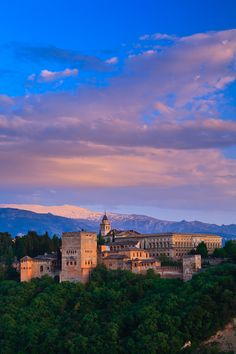 The Alhambra Palace, Granada, Andalusia | Spain. One chilly afternoon i shared wine out of plastic cups with the locals waiting in line to visit the Alhambra and gave a cheers to the first snow of the season that started falling all around us.