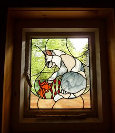 Cat at fishbowl Stained glass cattery window