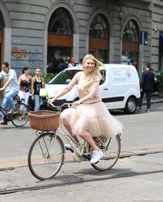 she's so adorable. #ZhannaBianca peddling around Milan in tulle. aces. #LeeOliveira