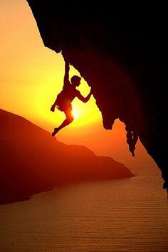 Rock climbing at sunset above the Aegean Sea    © Stuart McNeil