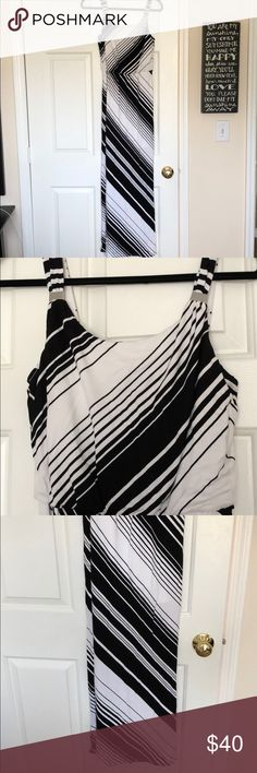WHBM Zig Zag Maxi Dress Selling for my mom! She takes great care of her clothes so condition is great! One TINY mark that I believe will come out in the wash but cannot be seen while wearing! Heavier cotton material! Black and white zig zag design! Selling dress as is! White House Black Market Dresses