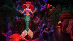 Ariel floats underwater at Under the Sea ~ Journey of The Little Mermaid