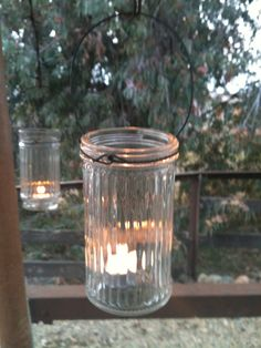4 Hanging Light Jar Lamp Candle Lantern - Wedding Decor, Outdoor Dinner Party Holidays, Luminary. $16.50, via Etsy.
