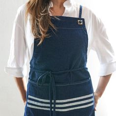 The Icon Denim Apron is named for the timeless fabric that has been built into an American icon. This classic bib apron combines comfort with utility.