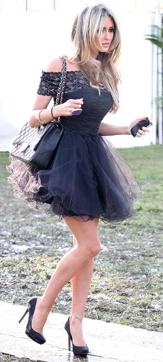 TOWIE babe Georgina Dorsett manages to look a million dollars at a rain-lashed, muddy polo match as she skilfully totters across a rickety walkway in sky-high stilettos.