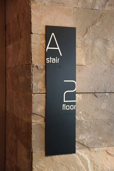 Example of floor-announcing wall signage at the Thompson LES Hotel, located in the Lower East Side, New York. Simple lines without extra decoration. Major design choice was to add edgy (litterallly) graphic tension by making the typography actually cut-off on the edges. This takes a lot of control. Well done.