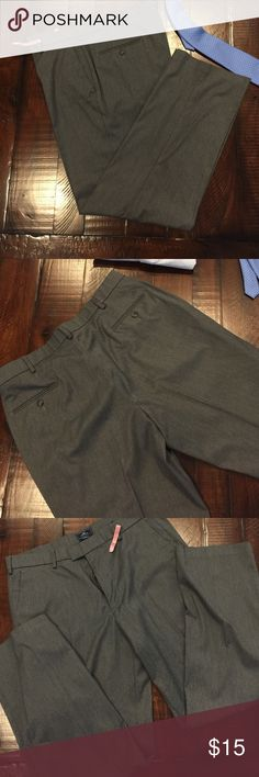 Excellent condition Docker dress pants Excellent condition men's Docker grey flat front dress pants. No rips or stains, Drycleaned and ready for a new home. 63% polyester 34%viscose 3% Lycra spandex classic fit size 36W 32 L grey dress slacks Dockers Pants Dress