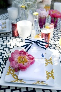 table setting:  navy and white trellis tablecloth with yellow accents