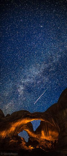 Perseid meteor streaking over the lightpainted double arch in Arches National Park.  #Photography #art Art and Photography
