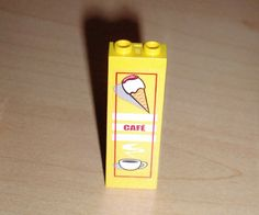 "BrickLink - Part 2454pb007 : Lego Brick 1 x 2 x 5 with Ice Cream Cone, ""CAFÉ"" and Coffee Cup Pattern (Sticker) - Set 4513. Get 10"