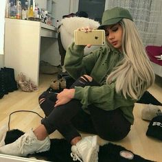 Olive baseball cap, olive ripped pullover hoodie, black ripped jeans, adidas sneakers