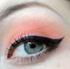 Coral eye-make-up w/ strong liner.