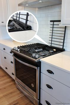 This gas cooktop makes clean up easier. The full-width cast iron grates on this Whirlpool model have EZ-2-Lift™ hinges at the back. Just hinge them open, wipe the surface clean and hinge down!    |   villagehomestores.com Paint Cabinets White, Painting Cabinets, Kitchen Village, Aspen House, Quad Cities, At Home Store, Cast Iron, Kitchen Design, Surface