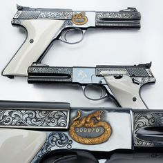 Engraved Colt Woodsman - In the Robert E. Petersen Gallery are many fine engraved arms, but today's Colt Woodsman .22 pistol is one of the Third Series guns that were made until 1977.  Heavy barrels in either 4.5 or 6 inch lengths were offered in this variation. But we think the poised golden rattlesnake near the serial number is the neatest aspect of its embellishments without putting down in any way the ivory grip panels or gold outline inlays.